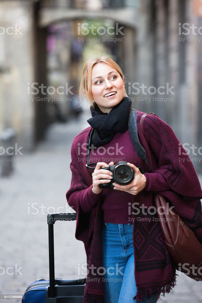 Girl taking picture with camera in the town stock photo