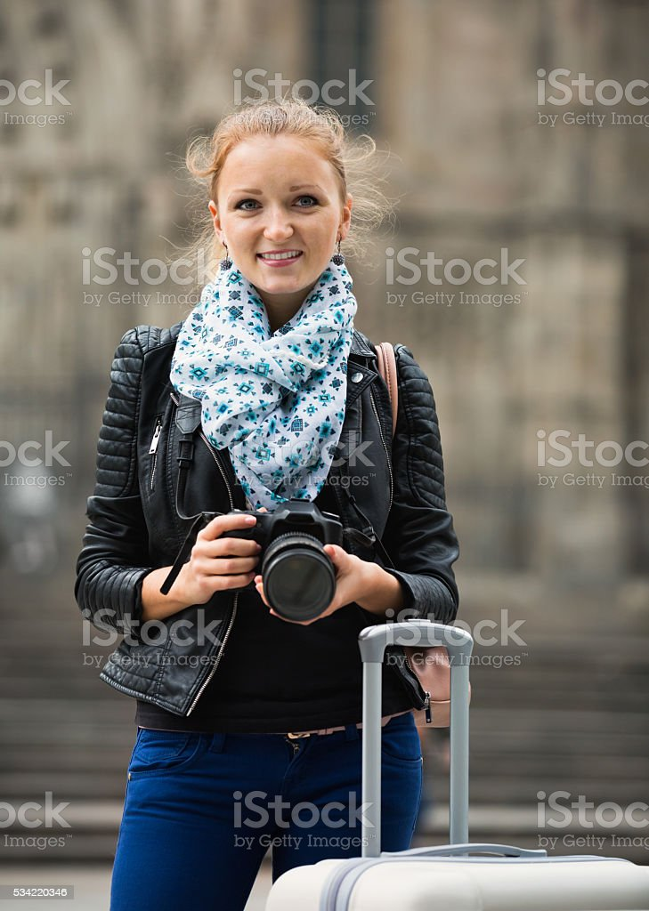 girl taking pictures of sights at city excursion stock photo