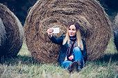 Girl taking selfie in the field