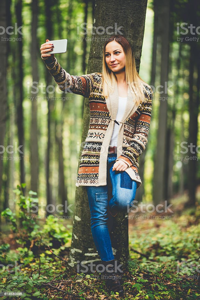 Girl taking selfie in the nature stock photo