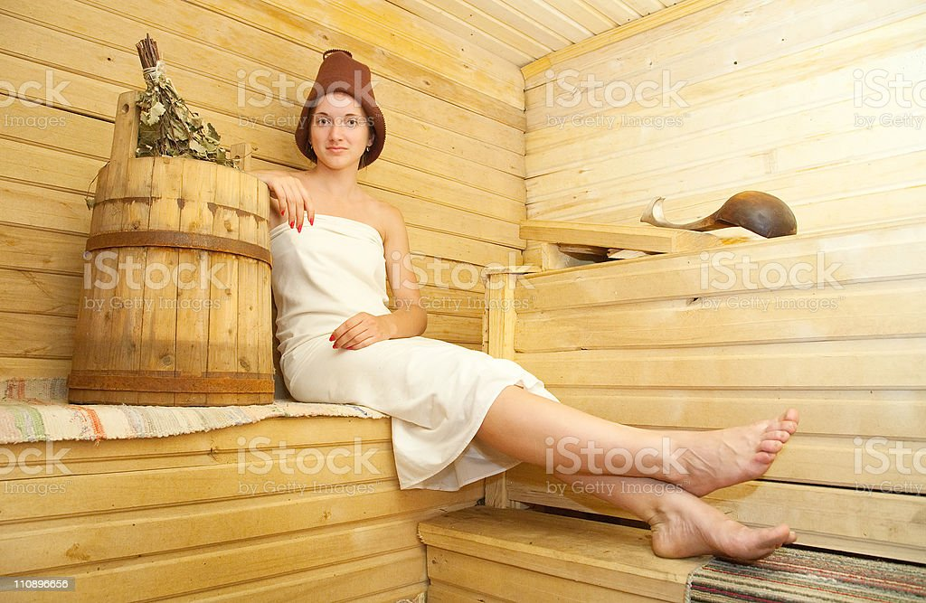 Girl taking steam bath stock photo