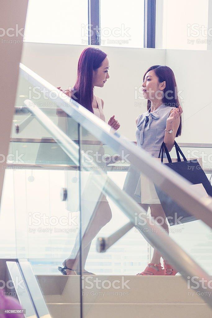 Girl Talk at Luxury Mall in Kowloon Hong Kong China stock photo