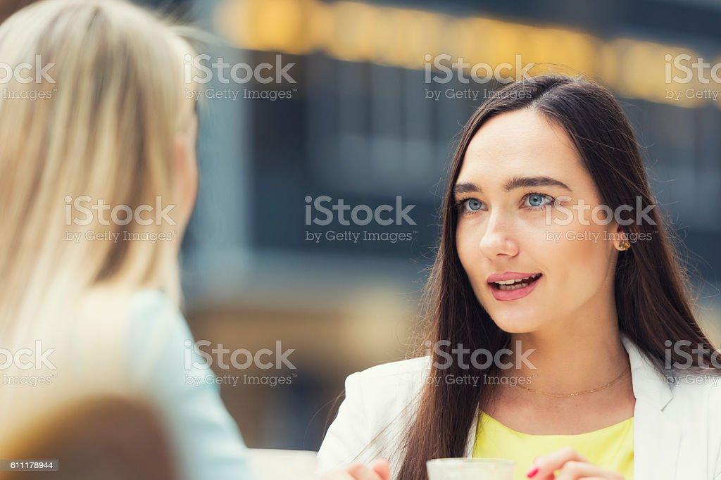 Girl talk gossip stock photo