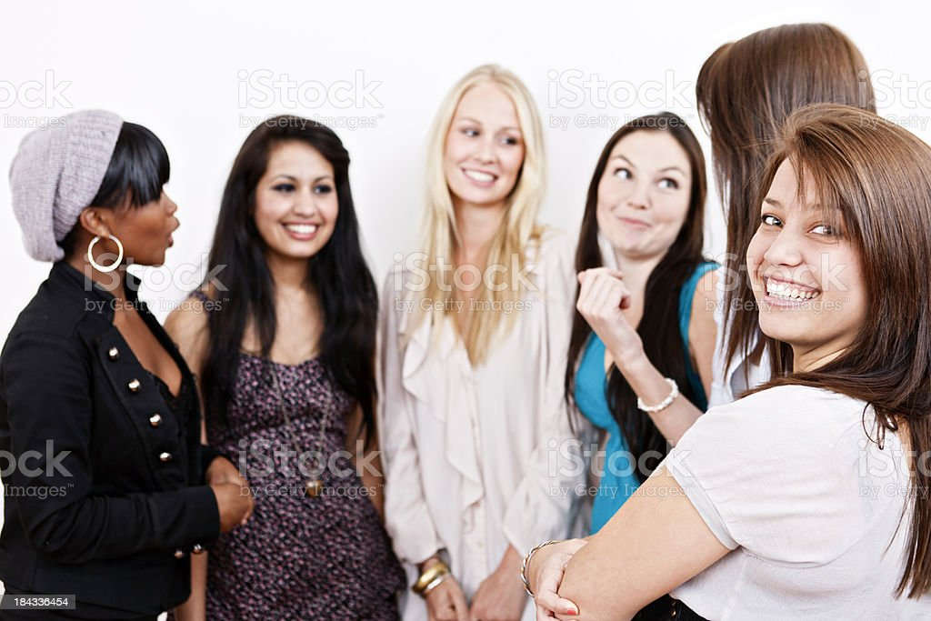 Girl talk in action as six young women chat cheerfully stock photo