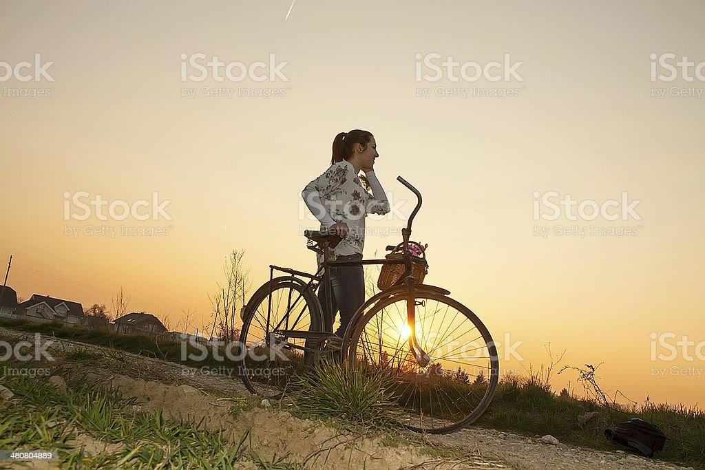 Girl talking on mobile phone stock photo