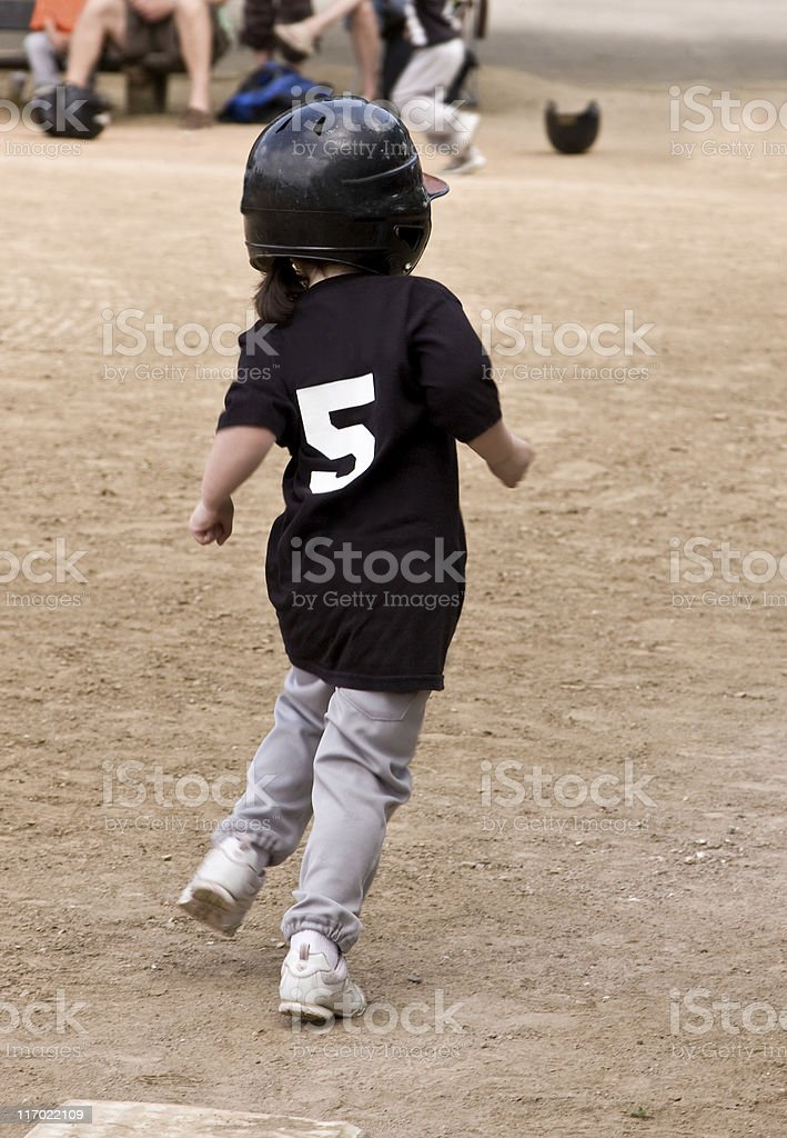 Girl t-ball player stock photo