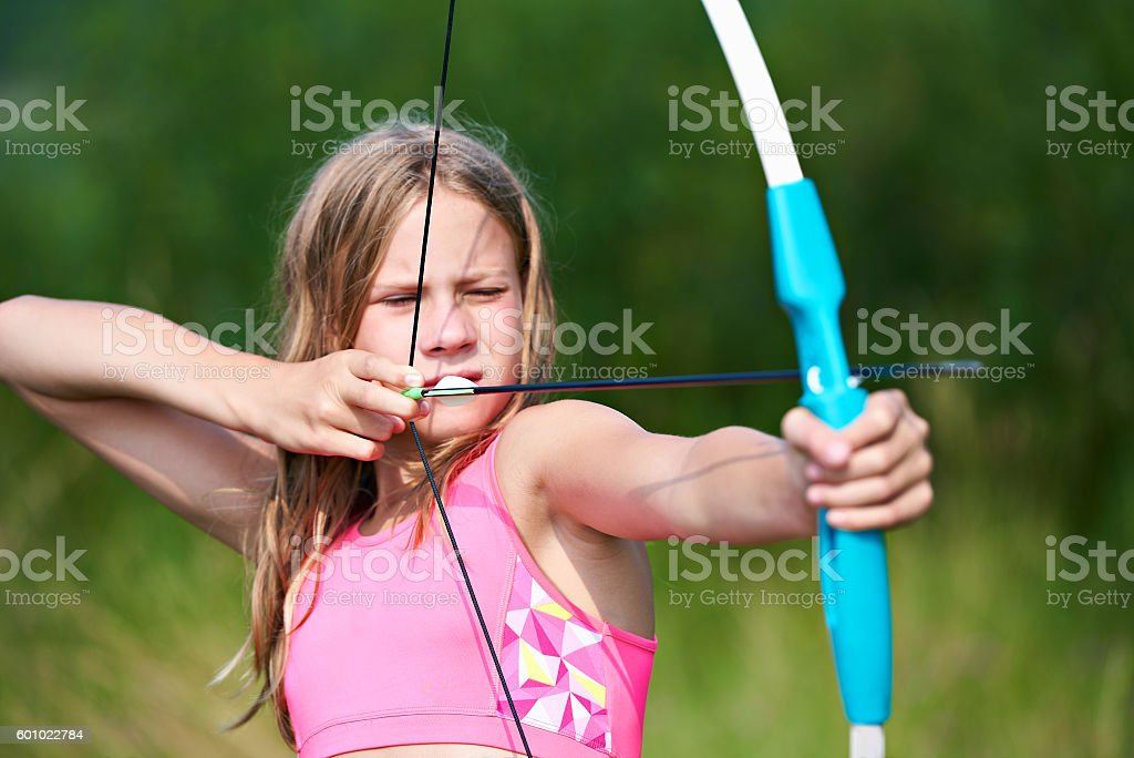 Girl teenager with bow nock and aims stock photo