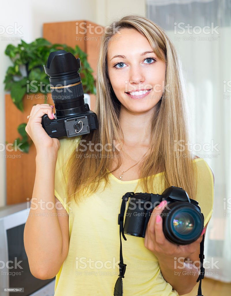 Girl testing  professional cameras stock photo