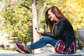 Girl texting and listening to music
