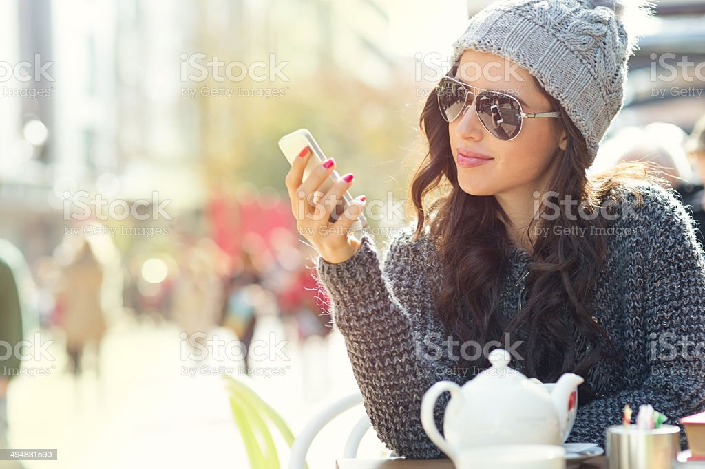 Girl texting on a cell phone stock photo