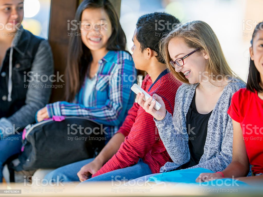Girl Texting on Her Cell Phone stock photo