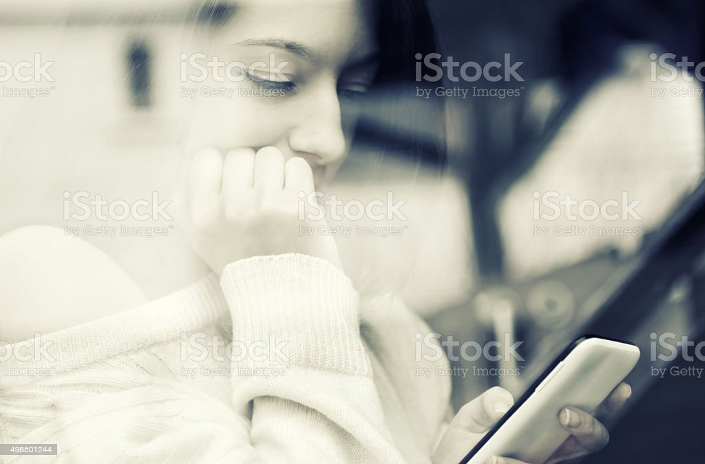 Girl texting on smartphone stock photo