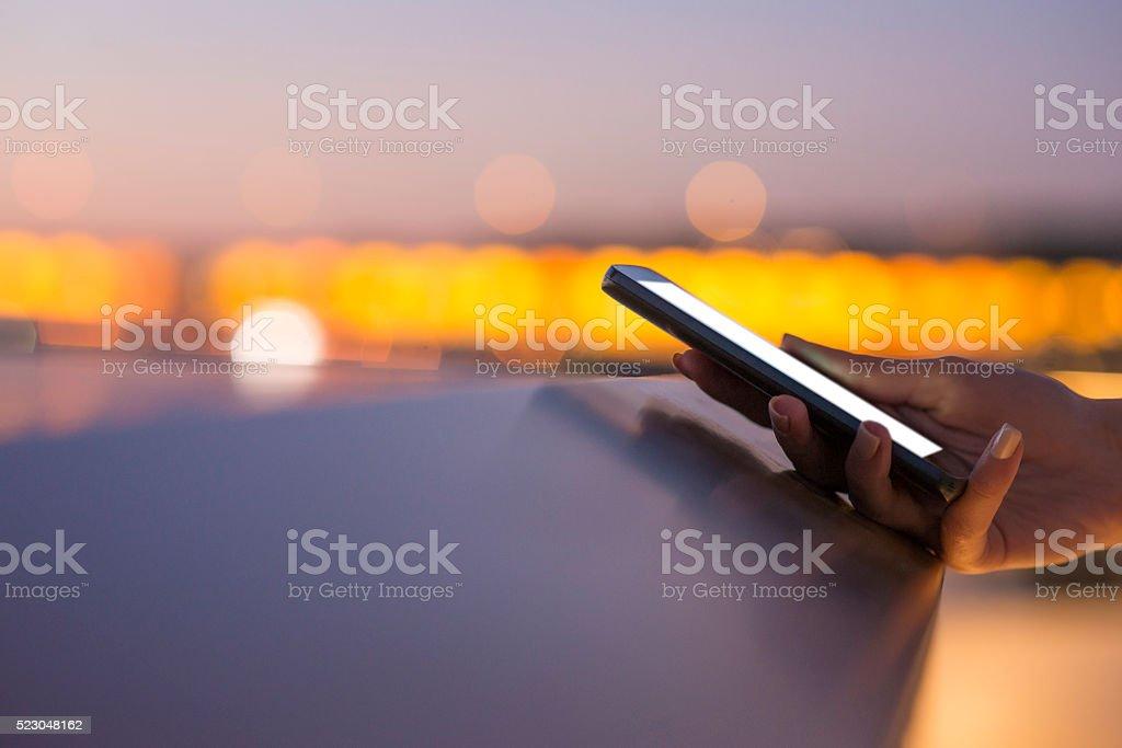 Girl texting on smartphone stock photo