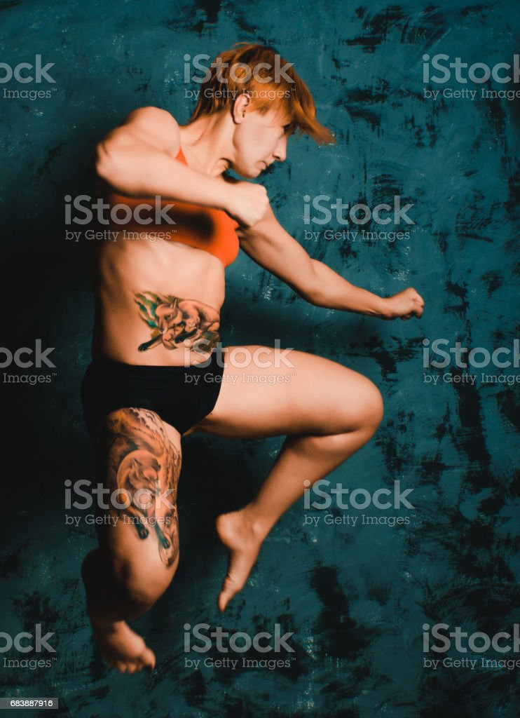 girl Thai box, kick stock photo