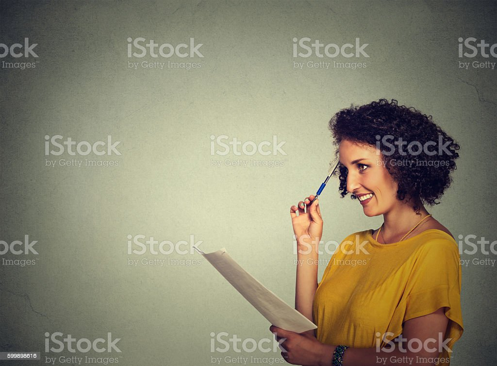 girl thinking making plans writing down ideas stock photo