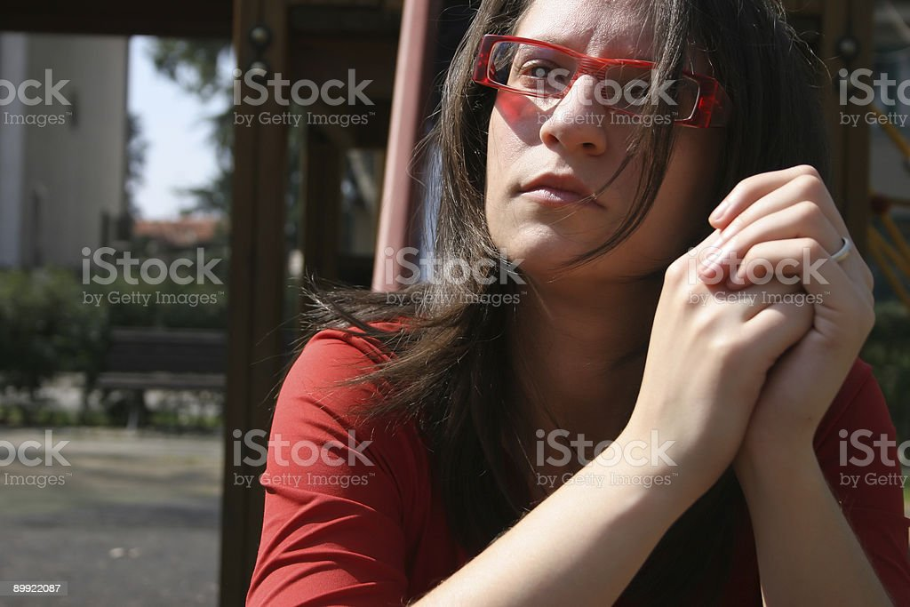 girl thinking with red glasses stock photo