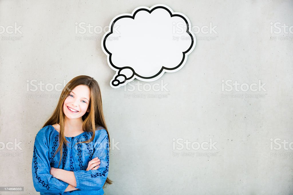 Girl thinking with thought bubble stock photo