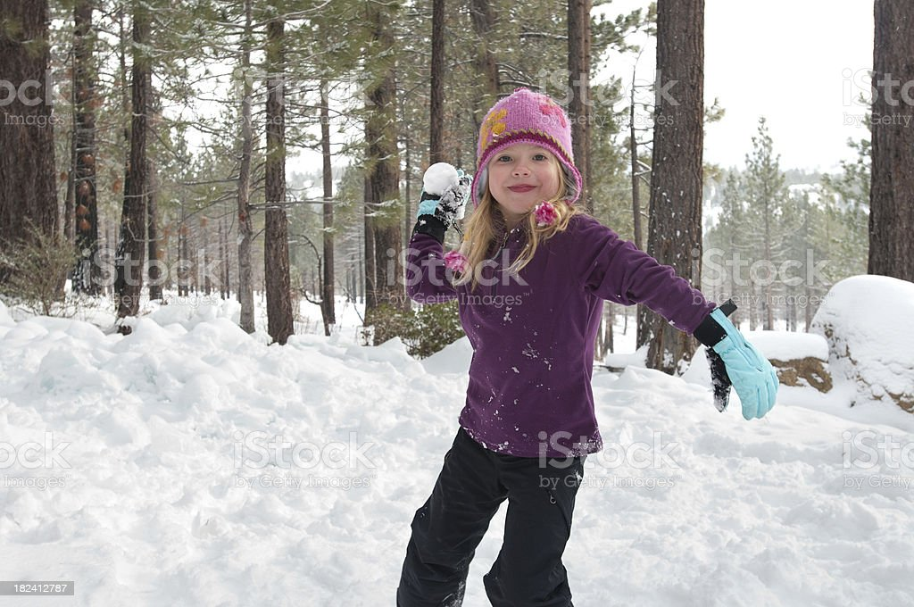 Girl Throwing Snowball royalty-free stock photo