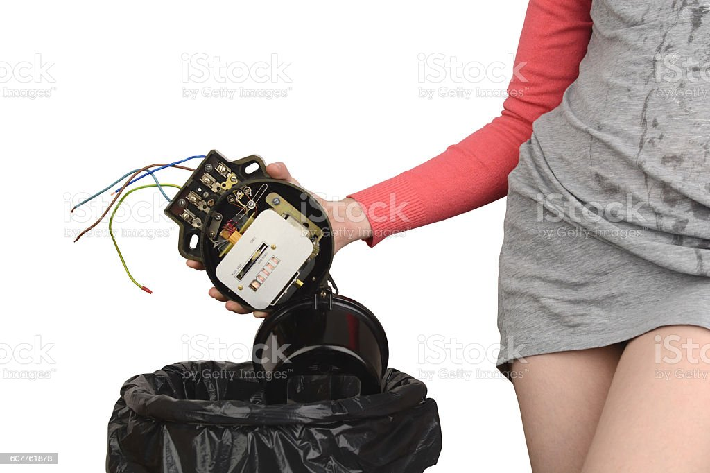 girl throws out the old electric meter stock photo