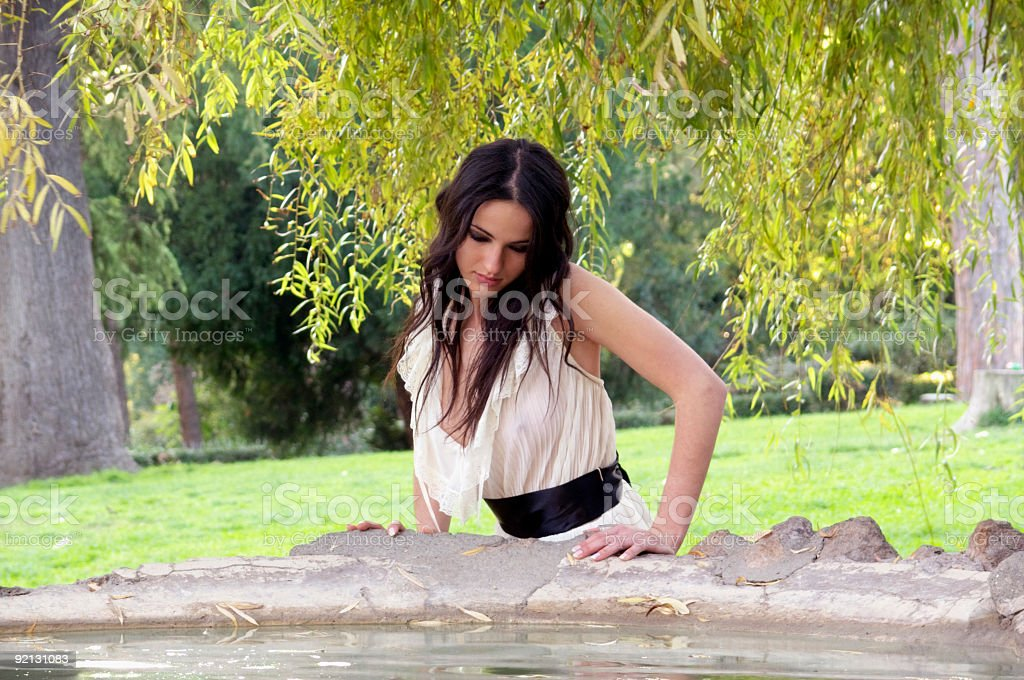 Girl to mirror oneself in the water stock photo