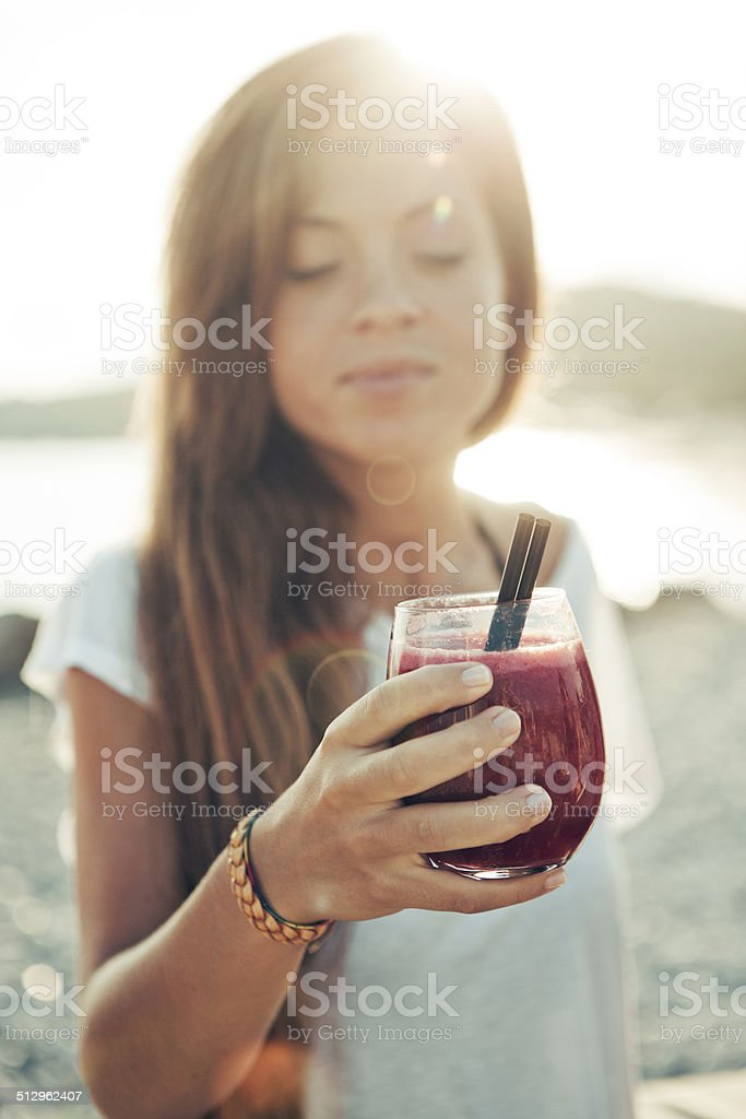 girl toasting with a cocktail stock photo