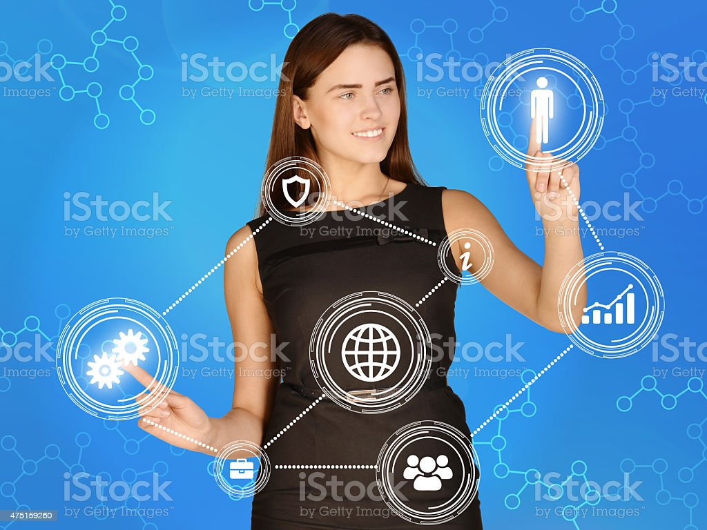 Girl touches the human icons and gears stock photo