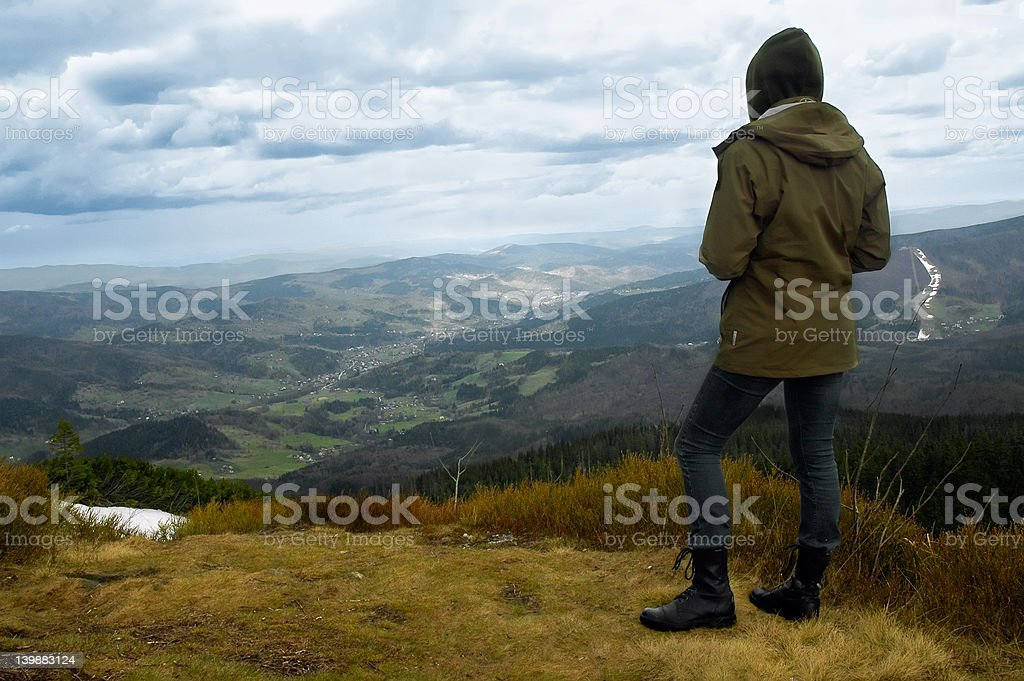 Girl tourist at the top of summit royalty-free stock photo