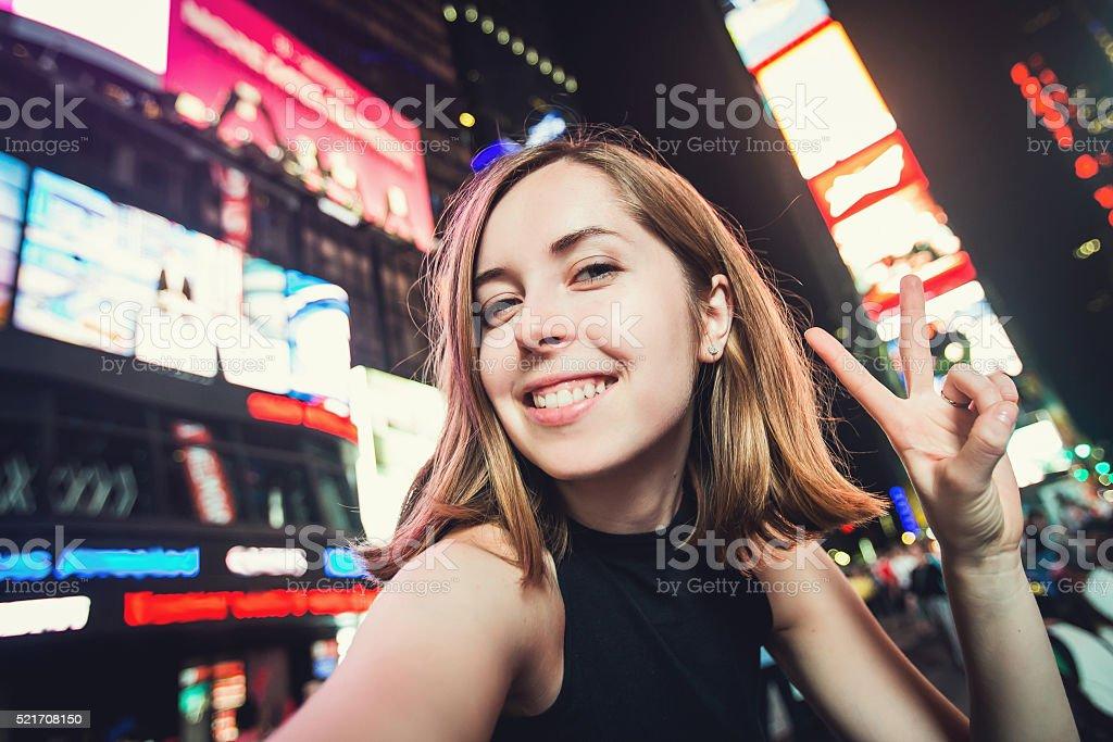 Girl tourist takes selfie photo, Times Square, New York stock photo