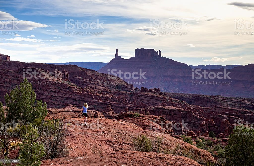 Girl Trail Running in Castle Valley stock photo