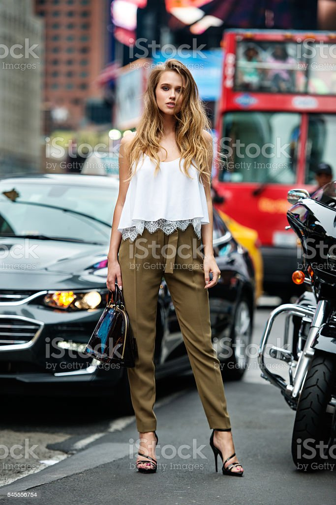 Girl traveling and shopping in New York City at summer. stock photo