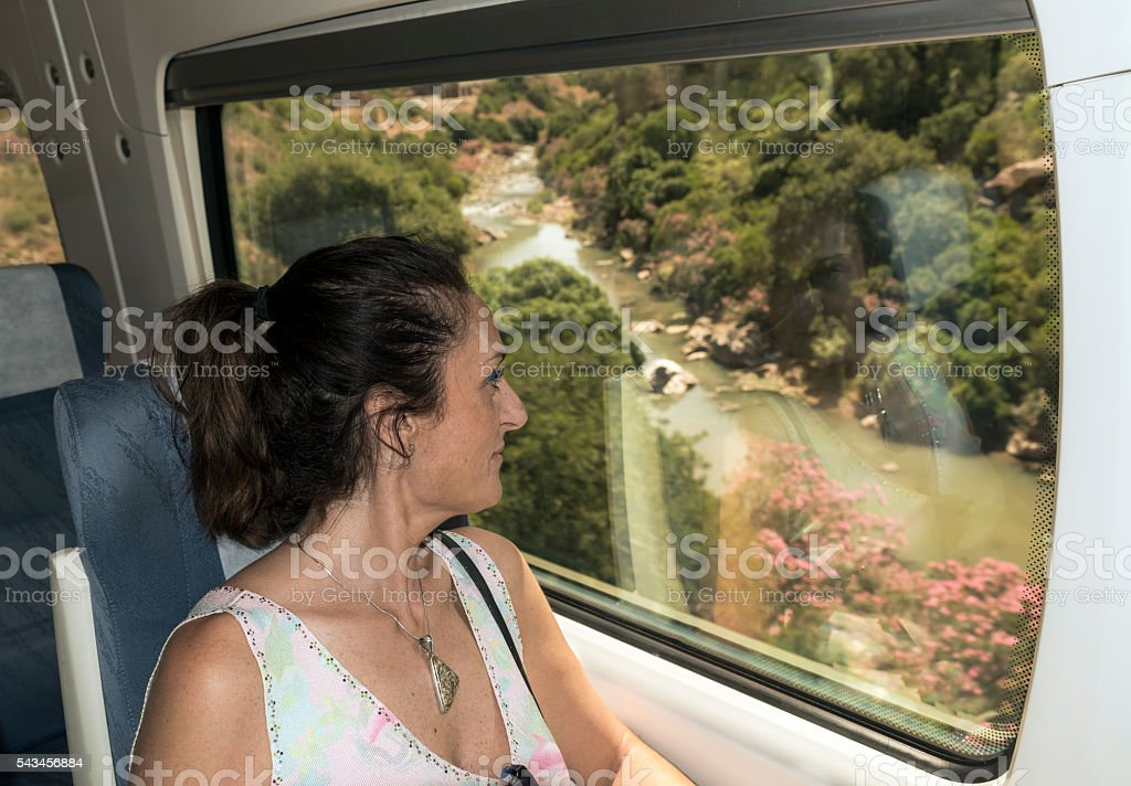 girl traveling by train stock photo