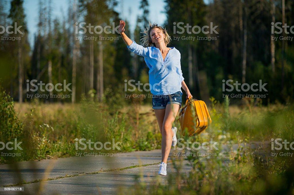 Girl traveling hitchhiking stock photo