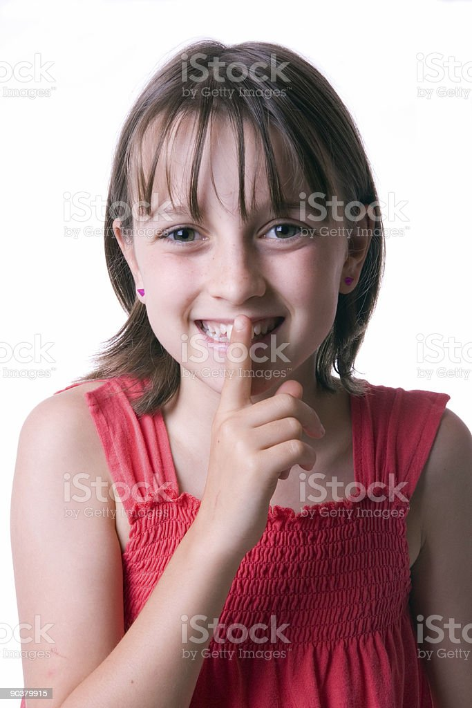 Girl trying to be Silent stock photo