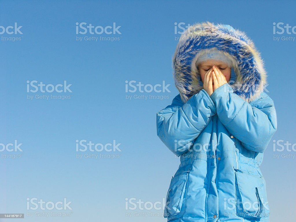 Girl trying to warm her face stock photo