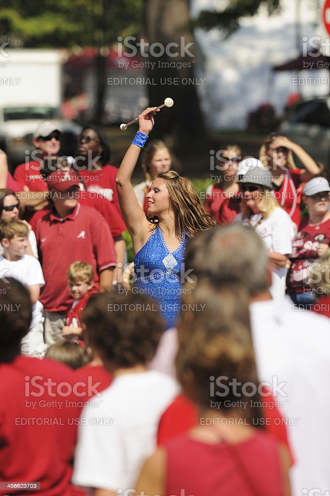 Girl twirling baton in homecoming parade stock photo