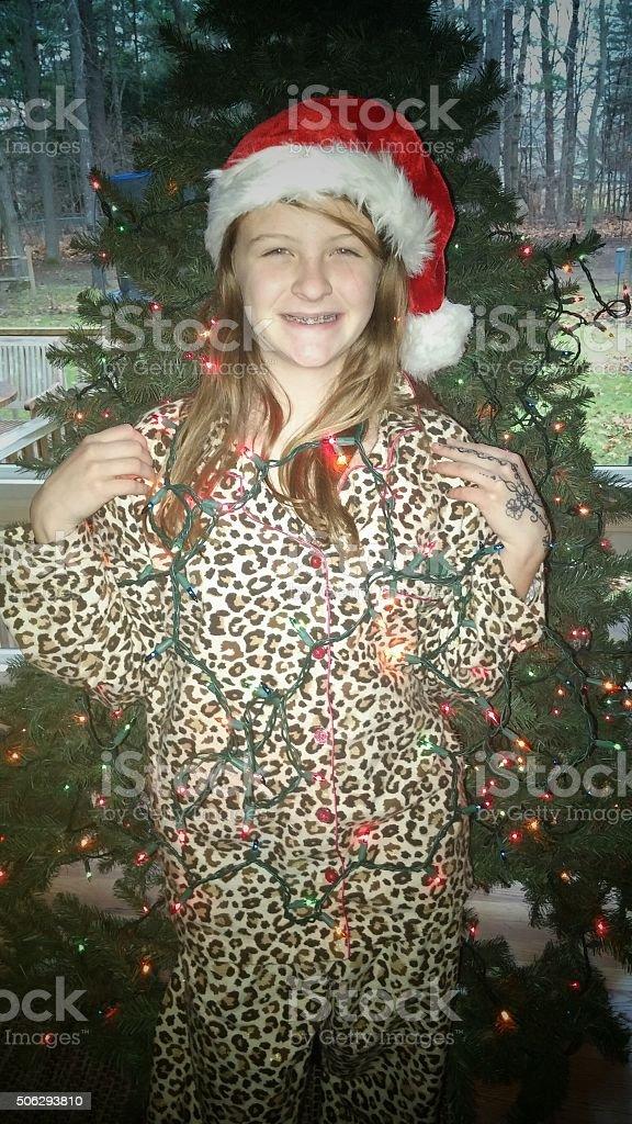 Girl, Ugly Christmas Tree String Lights, Santa Hat, Leopard Print stock photo