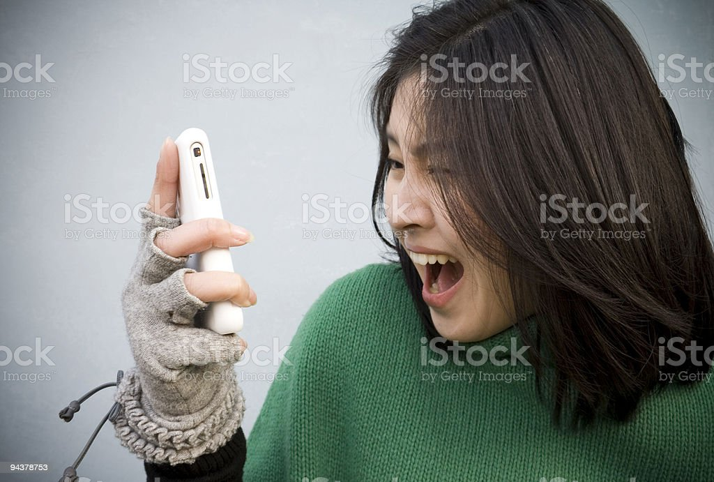 girl using a cell phone stock photo