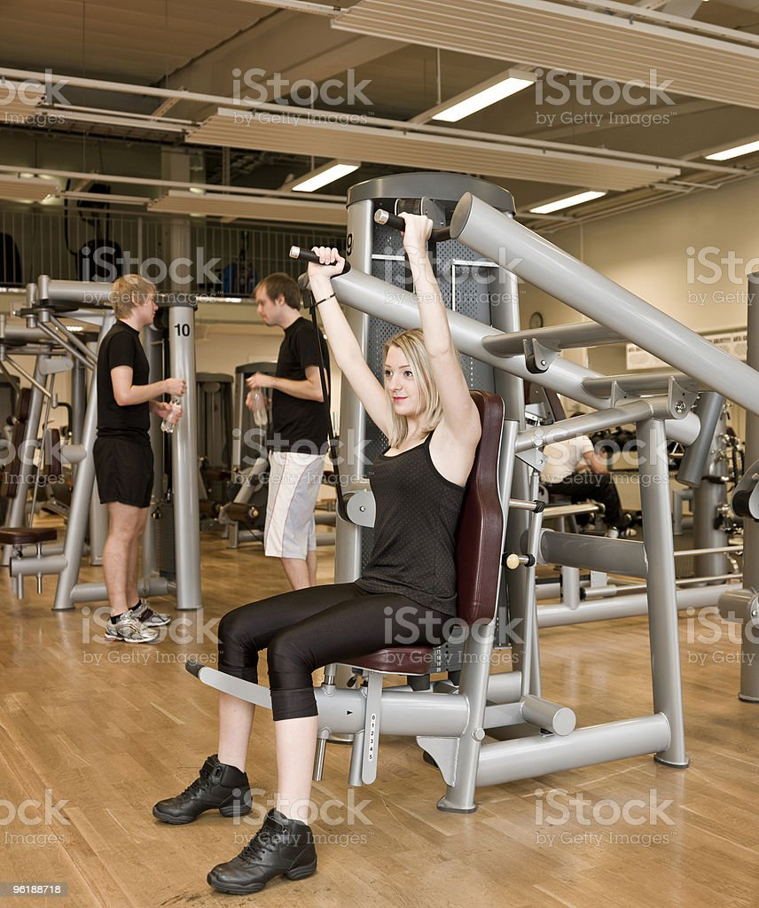 Girl using an exercise machine royalty-free stock photo