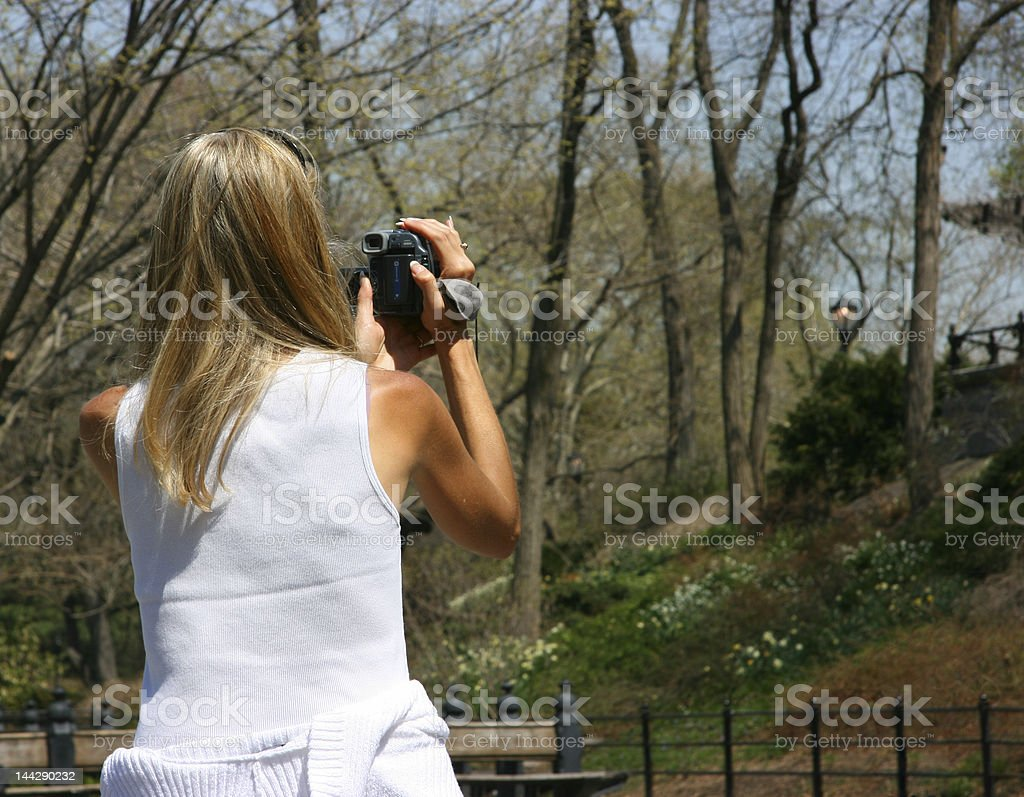 Girl using camcorder royalty-free stock photo