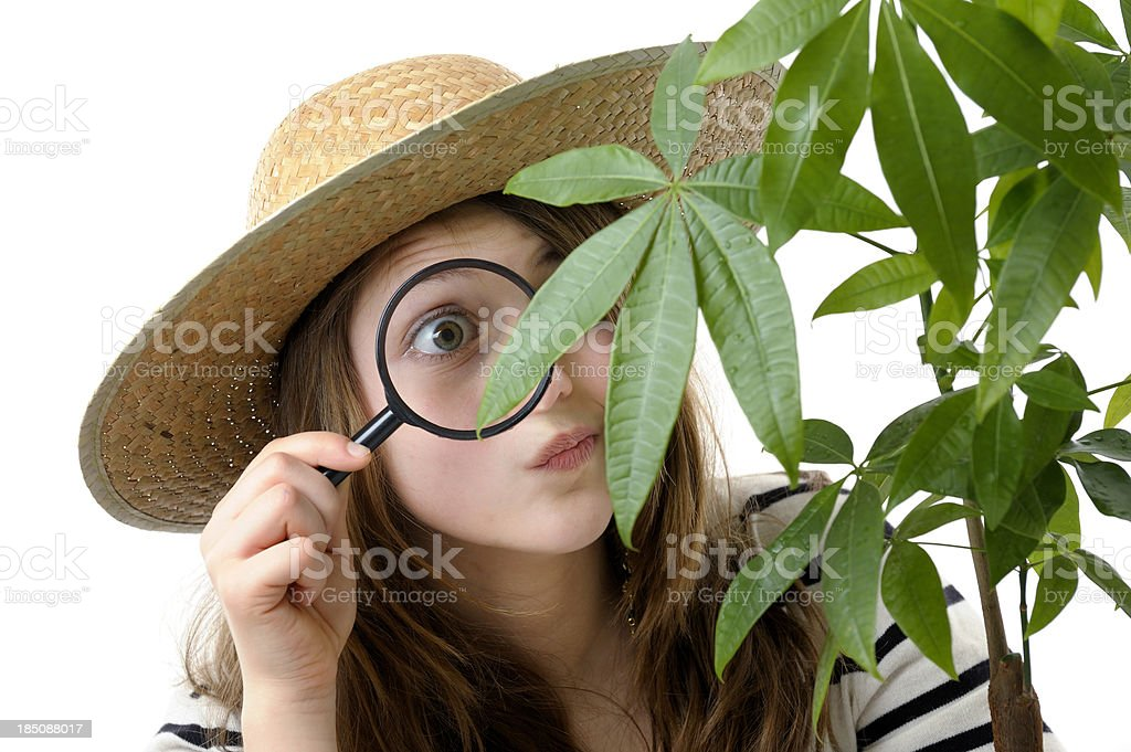 Girl using magnifier for exploration royalty-free stock photo