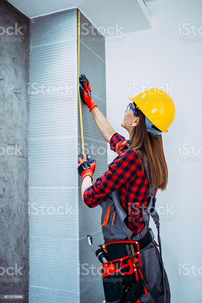 Girl using measuring tape stock photo