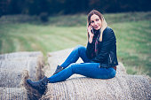 girl using phone in the field