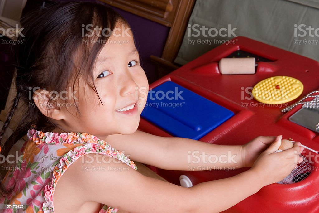 Girl using sensory station stock photo