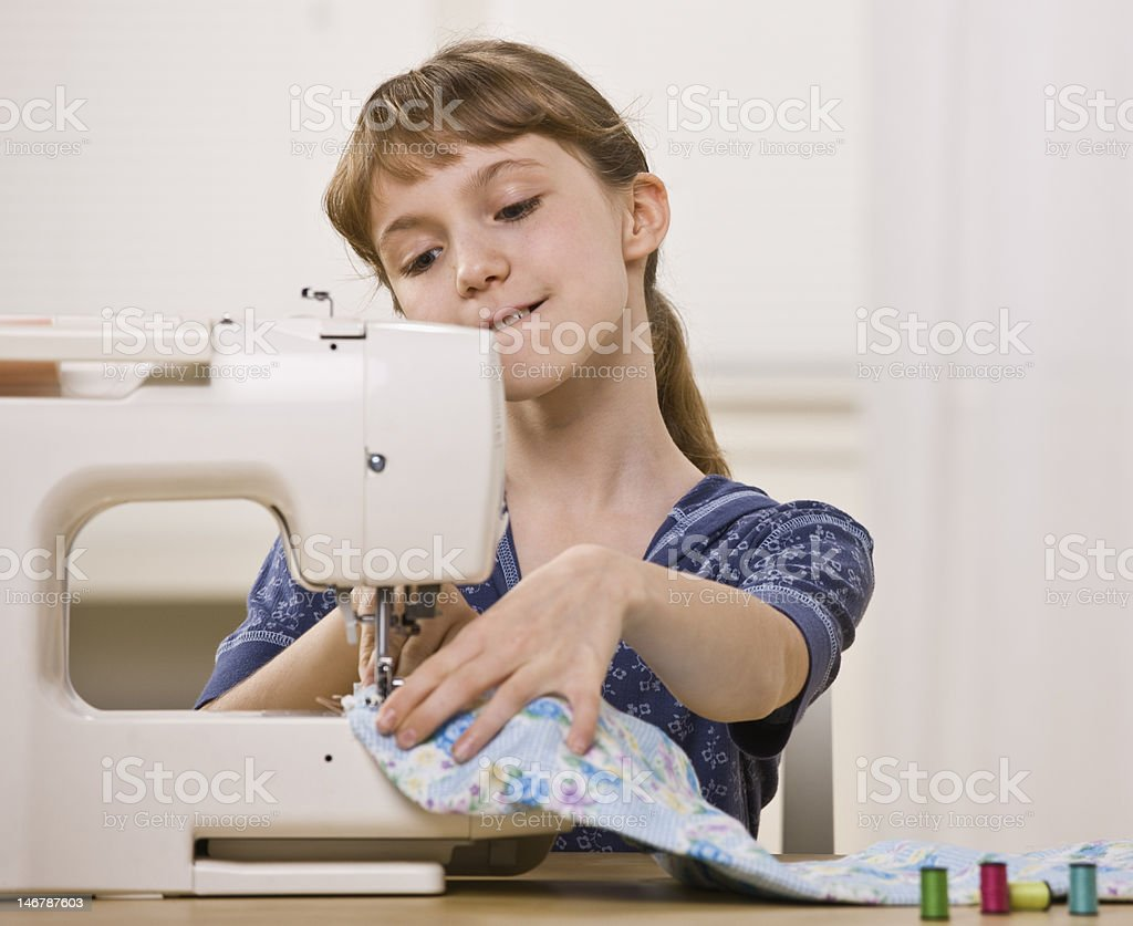 Girl Using Sewing Machine royalty-free stock photo