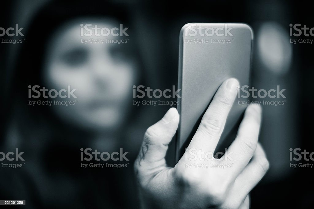 Girl using smartphone stock photo