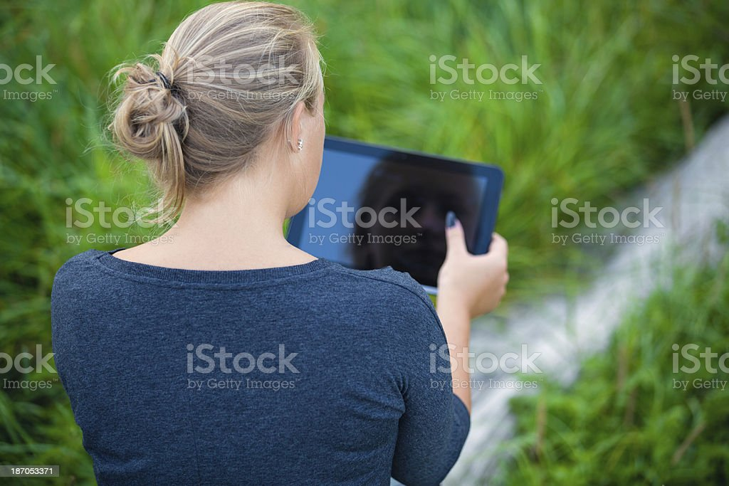 Girl using tablet royalty-free stock photo