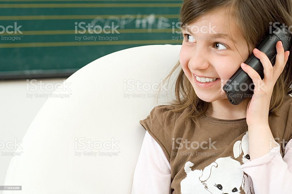 Girl using telephone stock photo