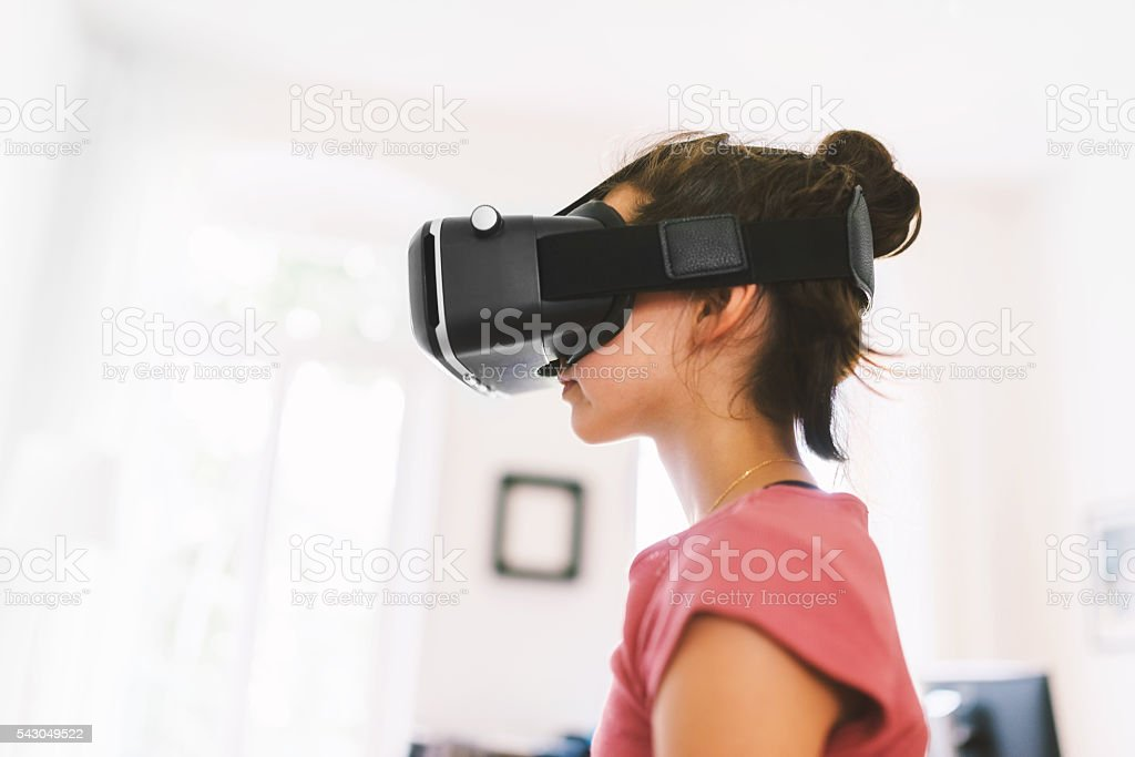 Girl Using Virtual Reality Glasses stock photo