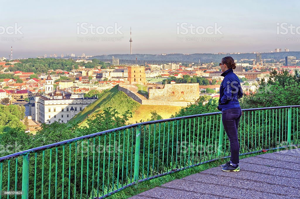 Girl viewing Gediminas Tower and Lower Castle in Vilnius stock photo