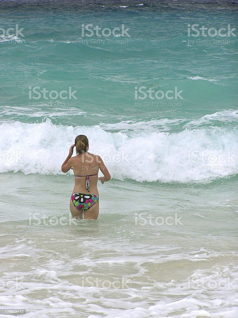 Girl wading into water royalty-free stock photo